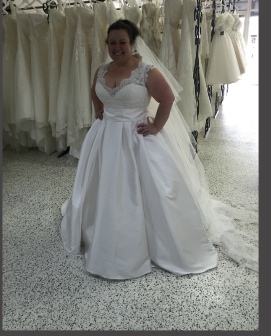 Plus sized bride feeling confident in her Gown